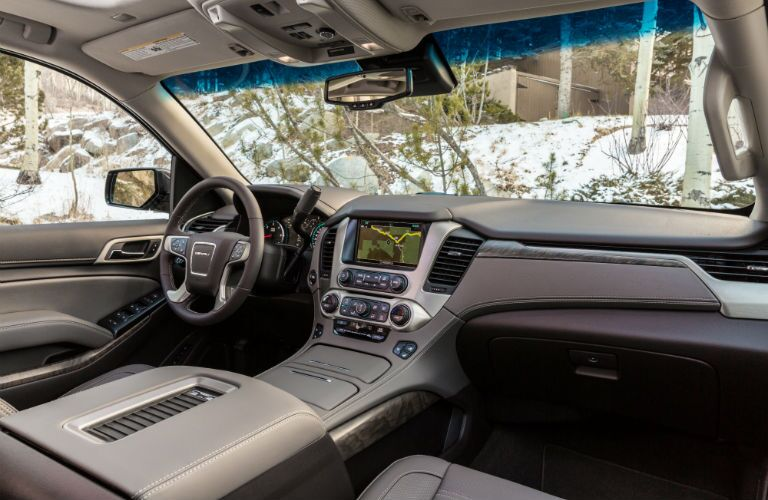 A photo of the front dashboard in the 2019 Yukon Denali.