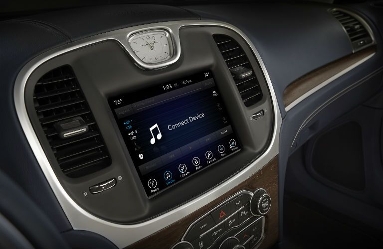 A close up photo of the infotainment system of the 2018 Chrysler 300.