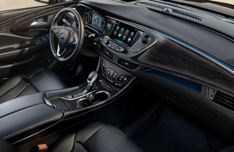 An interior photo showing the infotainment system and premium passenger cabin materials used in the 2018 Envision