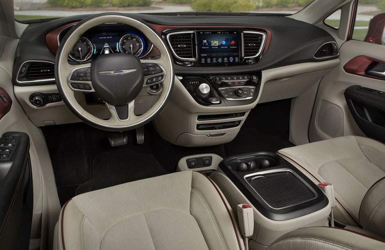 A photo of the dashboard of the 2018 Pacifica showing the new infotainment system which is now compatible with smartphone applications