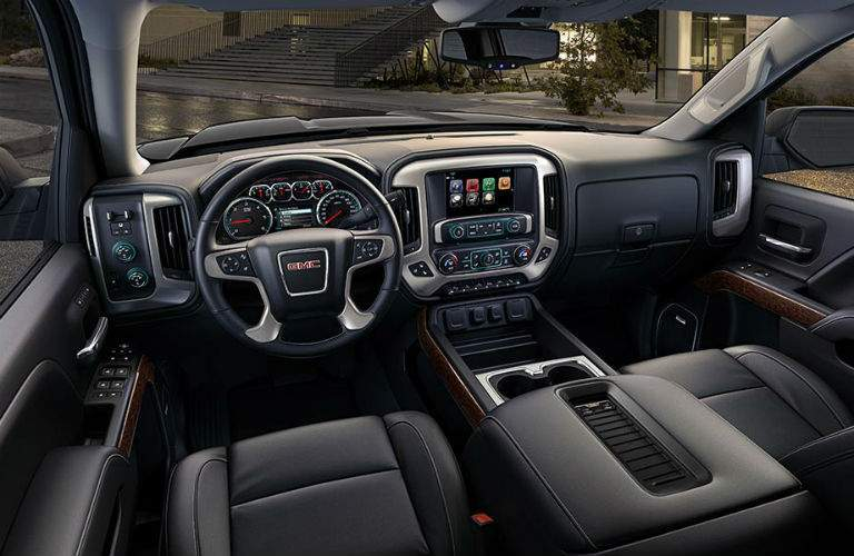 An interior view of the driver's seat and dashboard in the 2018 GMC Sierra