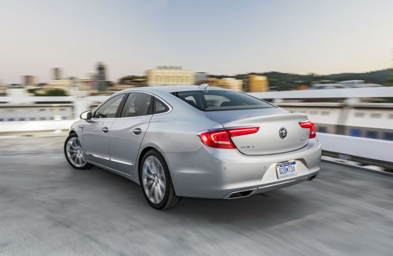 A rear left quarter photo of the 2018 Buick LaCrosse parked on a building.