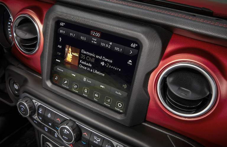 A close up photo of one of the available touchscreen interfaces in the 2018 Wrangler