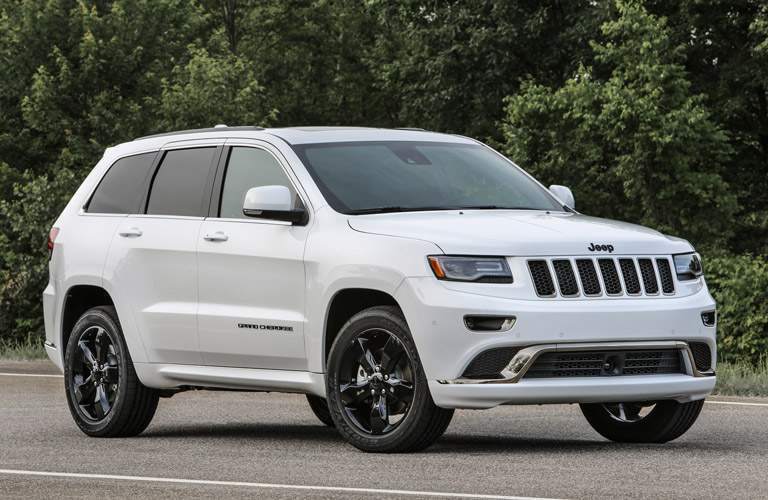 A photo of a white Jeep Grand Cherokee representing the dealership's certified pre-owned inventory