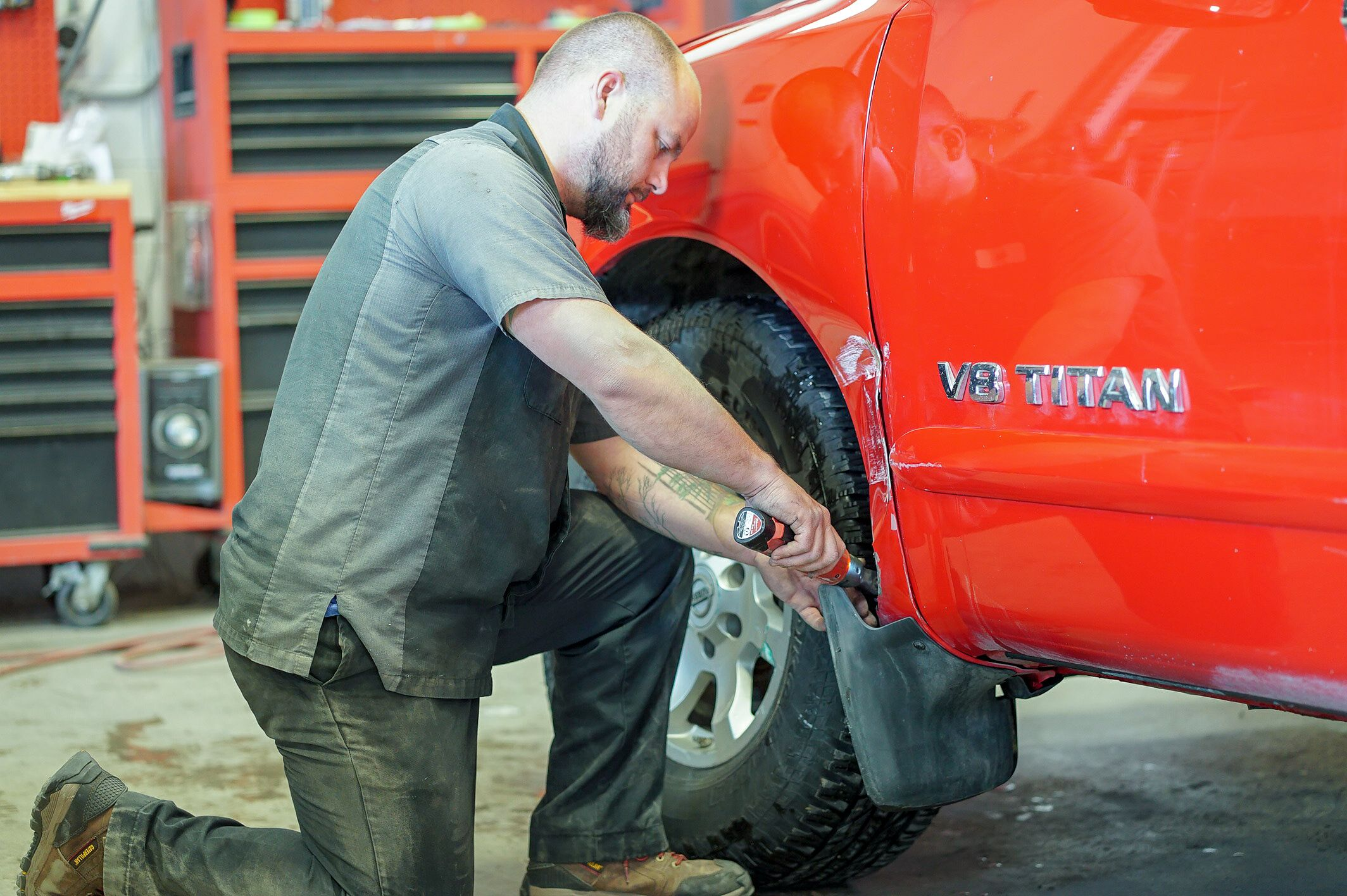 Photo of a body shop technician in the shop.