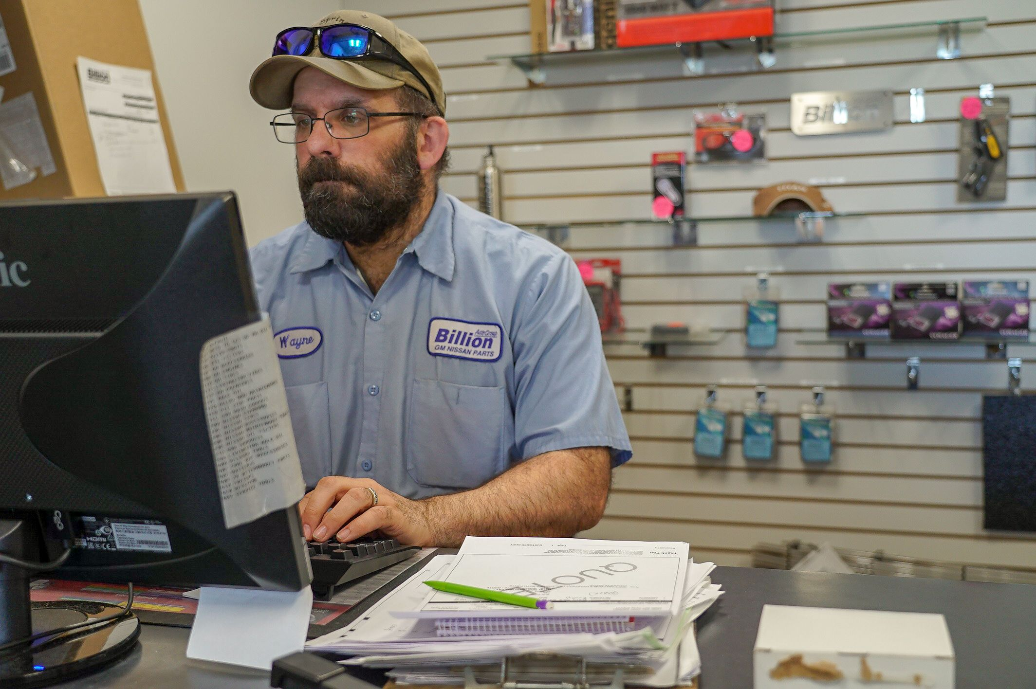 Photo of a parts department worker at the front desk