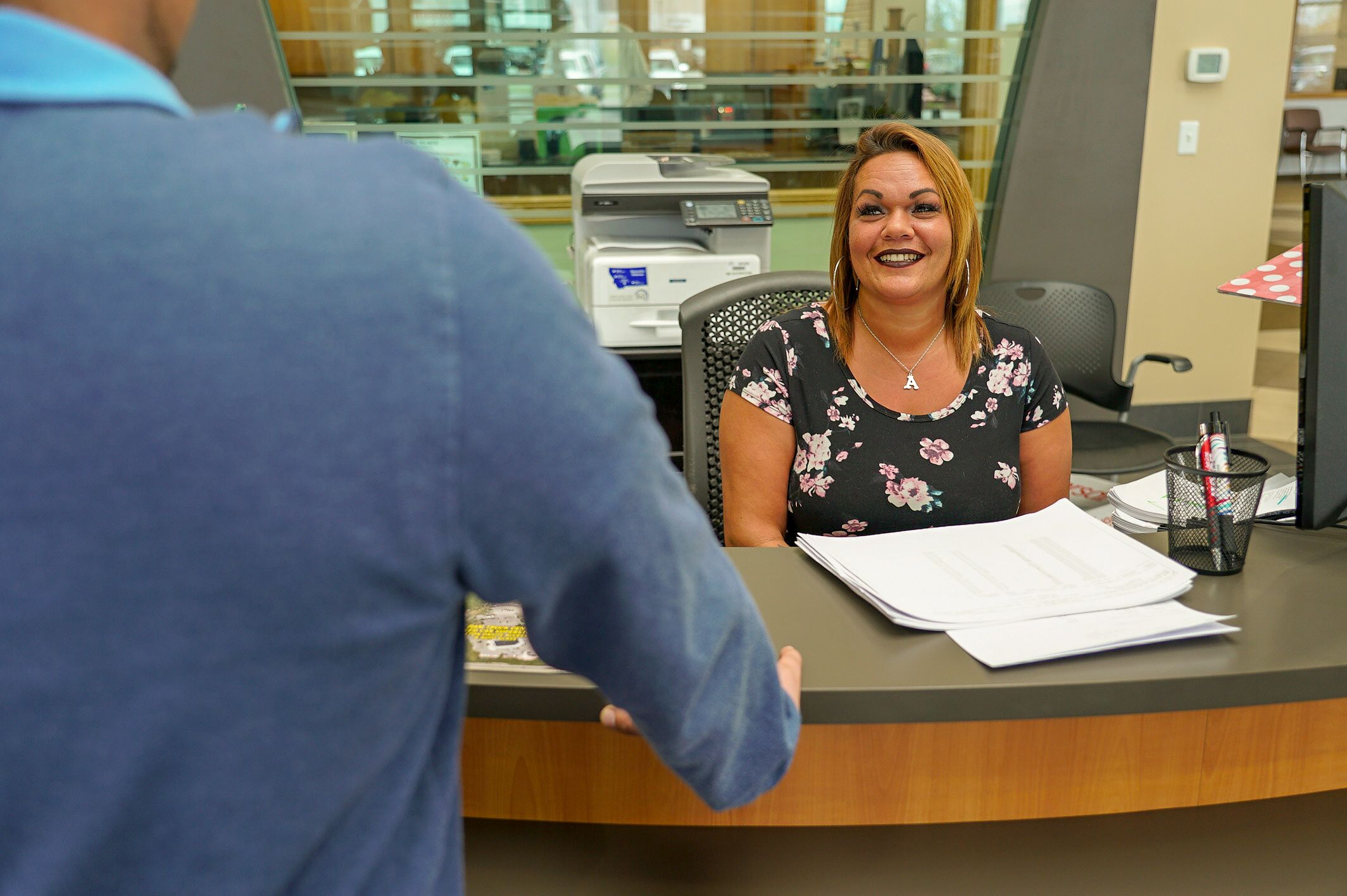 A photo of our front desk receptionist.