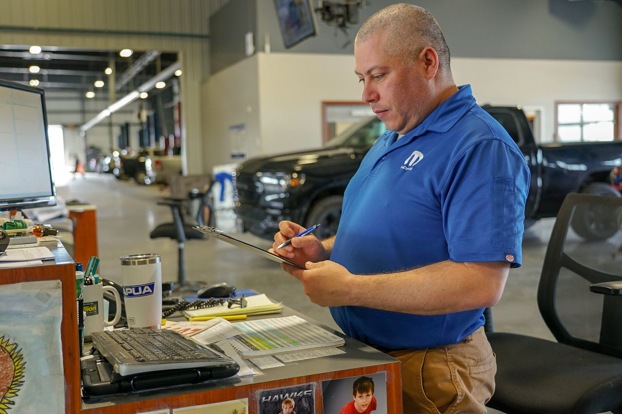 A photo of a service advisor on our service drive.