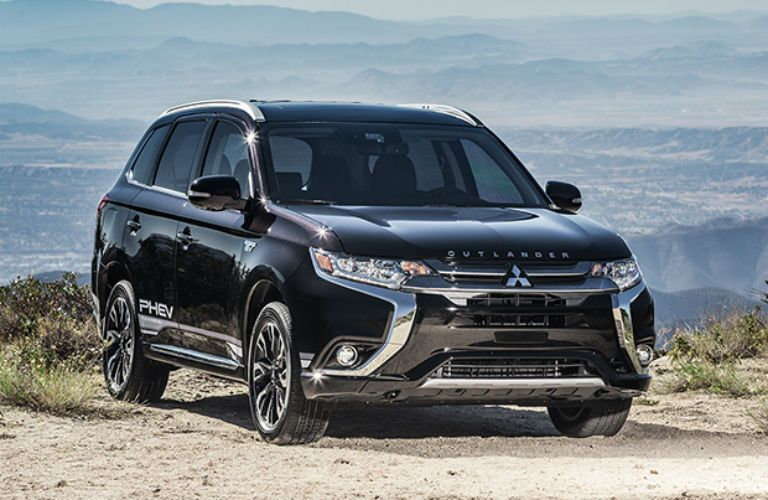 2018 Mitsubishi Outlander PHEV parked with a canyon in the background