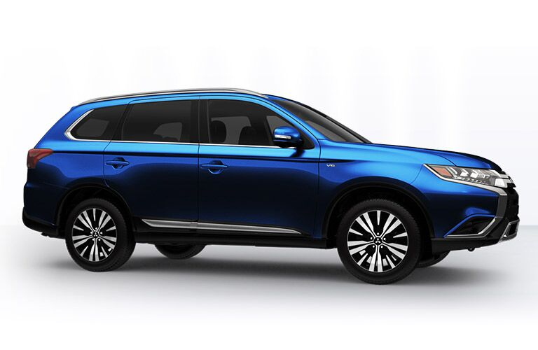 side view of blue 2019 mitsubishi outlander