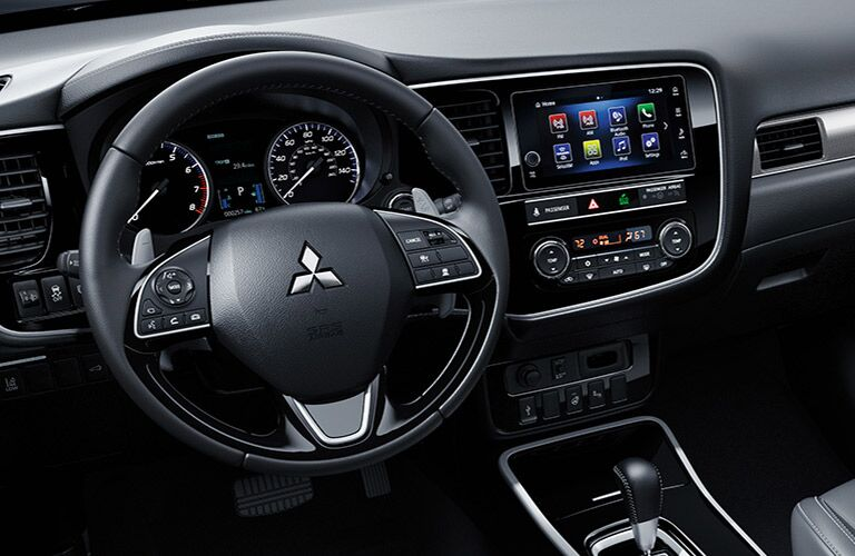 front interior of 2019 mitsubishi outlander including steering wheel and infotainment system