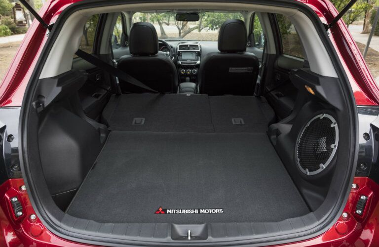 Cargo area of 2017 Mitsubishi Outlander Sport with collapsed seats