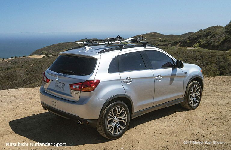 2018 Mitsubishi Outlander Sport exterior back fascia and passenger side on top of hill