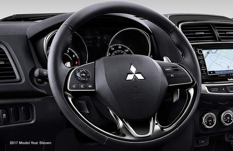 Steering wheel controls and driver information center of the 2018 Mitsubishi Outlander Sport