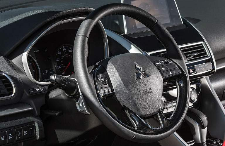 Steering wheel mounted controls and driver information center of the 2018 Mitsubishi Eclipse Cross