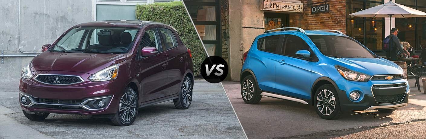 "Exterior view of a red Mitsubishi Mirage next to an exterior view of a blue 2018 Chevy Spark with a ""vs"" between them"