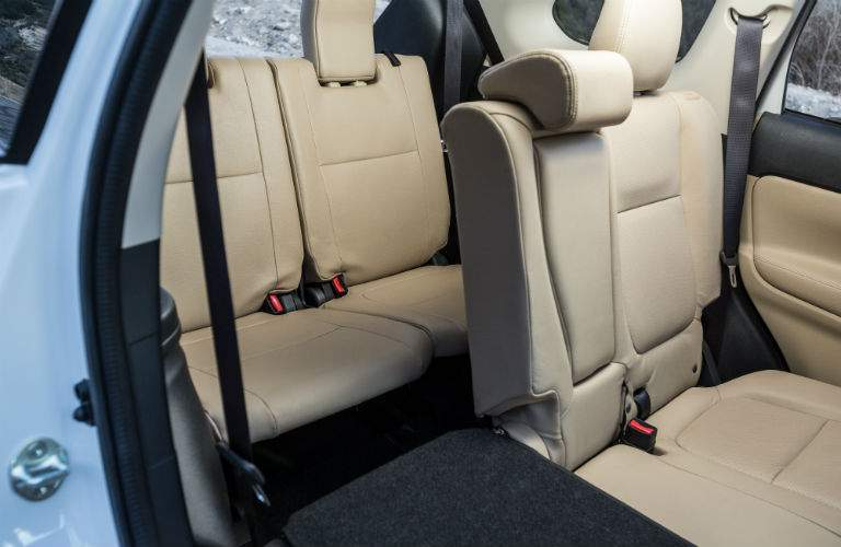 Side view of the 2018 Mitsubishi Outlander's easy access second-row seat into the third row of seating