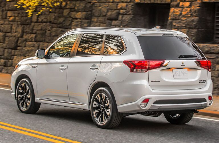 2018 Mitsubishi Outlander PHEV exterior back fascia and drivers side on road