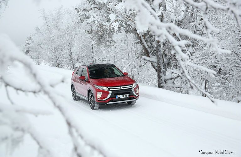 2018 Mitsubishi European model driving through snow