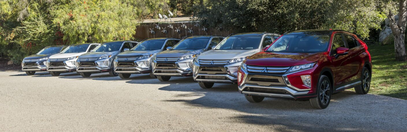 2018 Mitsubishi Eclipse Cross model lineup with trees behind them