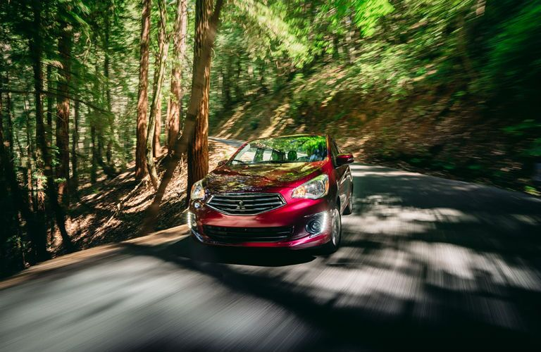 2018 Mitsubishi Mirage G4 driving through a wooded area