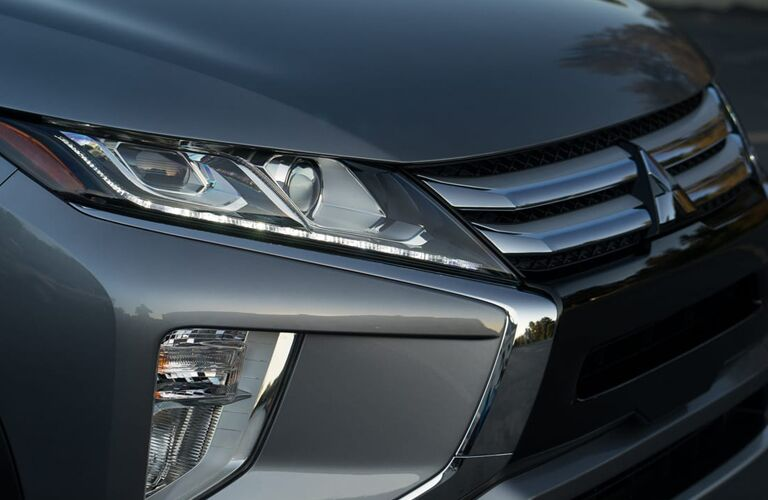 front end of silver 2019 mitsubishi eclipse cross including grille and headlamps