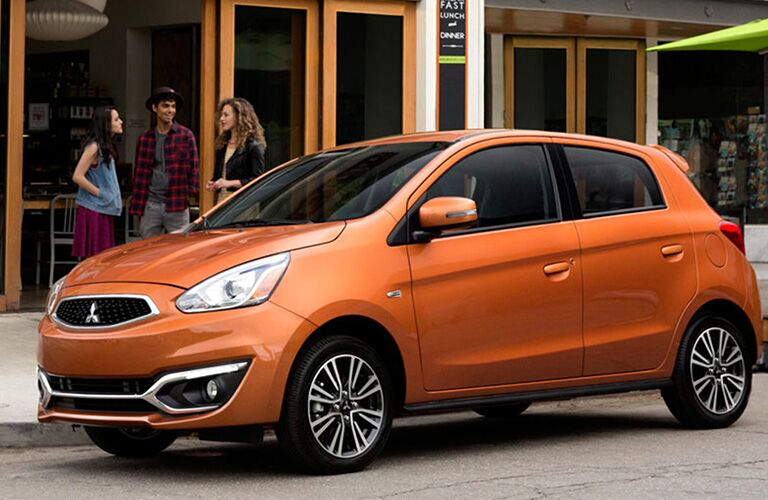 front and side view of orange 2019 mitsubishi mirage