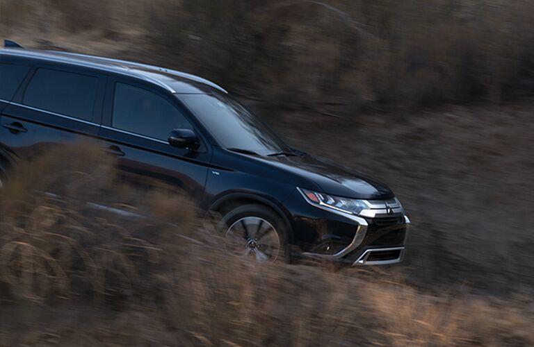 Blue 2019 Mitsubishi Outlander driving down hill