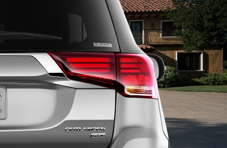 rear taillight and badging of silver 2019 mitsubishi outlander