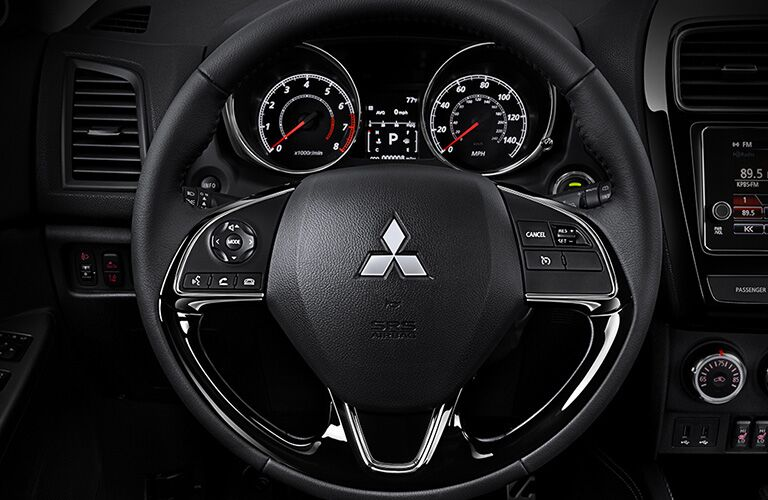 steering wheel and dashboard of 2019 mitsibushi outlander