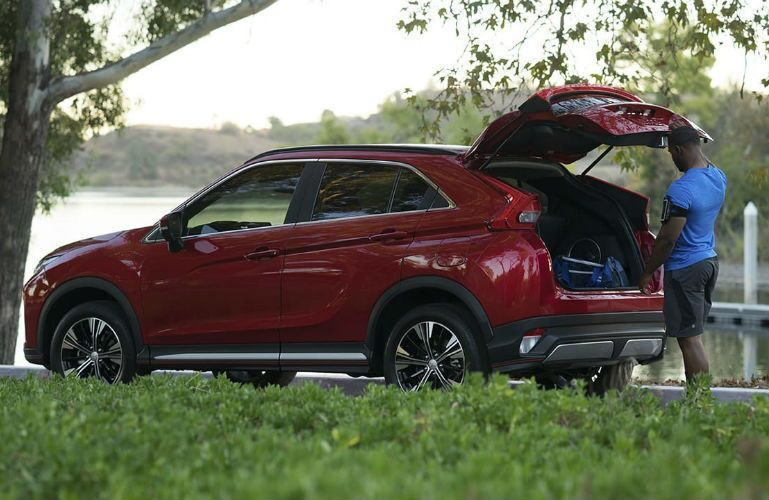 2019 Mitsubishi Eclipse Cross with man loading cargo in rear