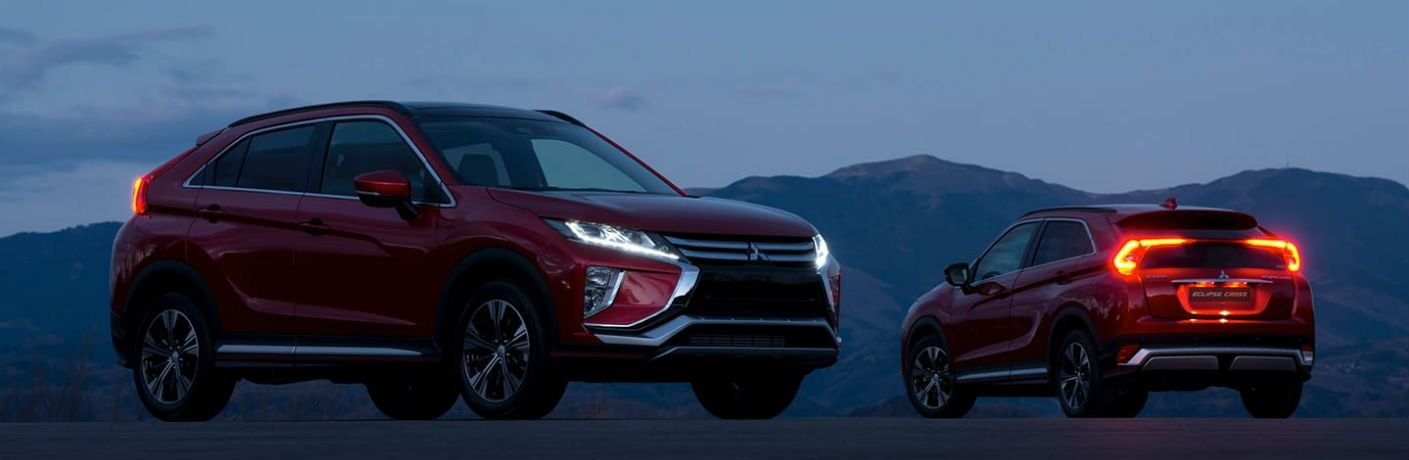 two 2019 Mitsubishi Eclipse Cross models parked in a desert at night
