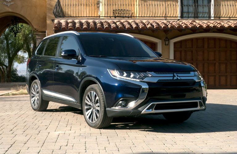 2019 Mitsubishi Outlander parked in front of a condo