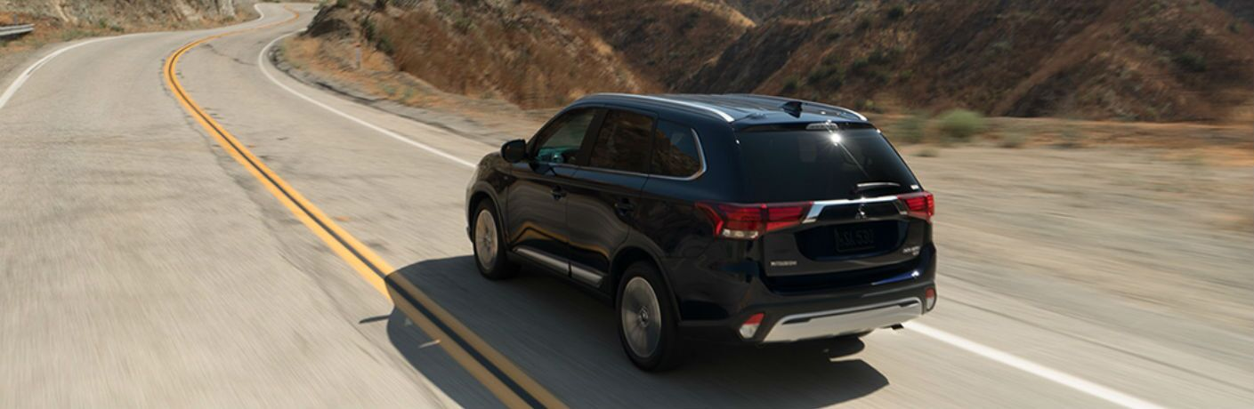 2019 Mitsubishi Outlander driving on a mountainous road