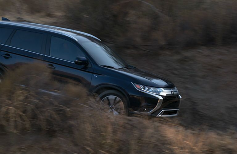 2019 Mitsubishi Outlander driving down a rural road