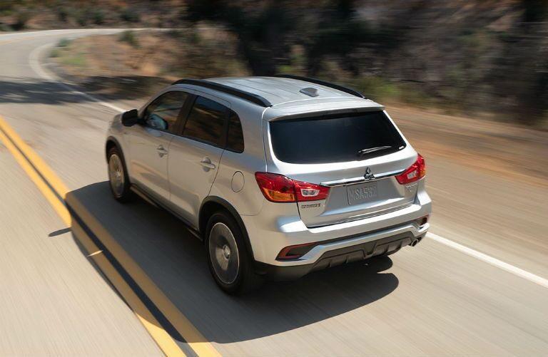 2019 Mitsubishi Outlander Sport driving up a hill