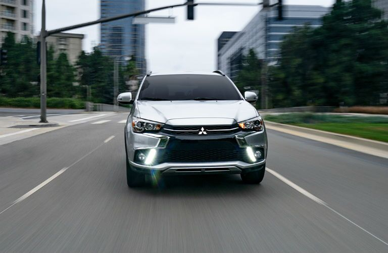 2019 Mitsubishi Outlander Sport driving towards the camera