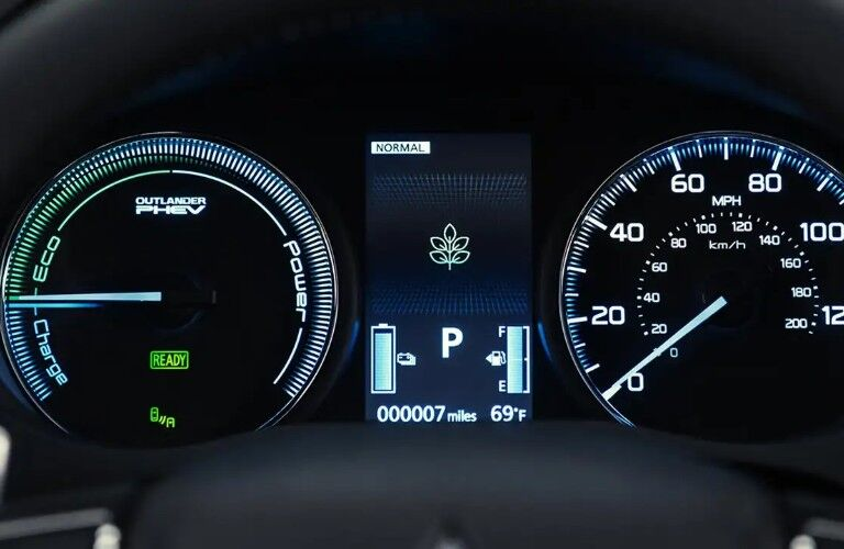 Close up of the speedometer and power gauges in the 2020 Mitsubishi Outlander PHEV