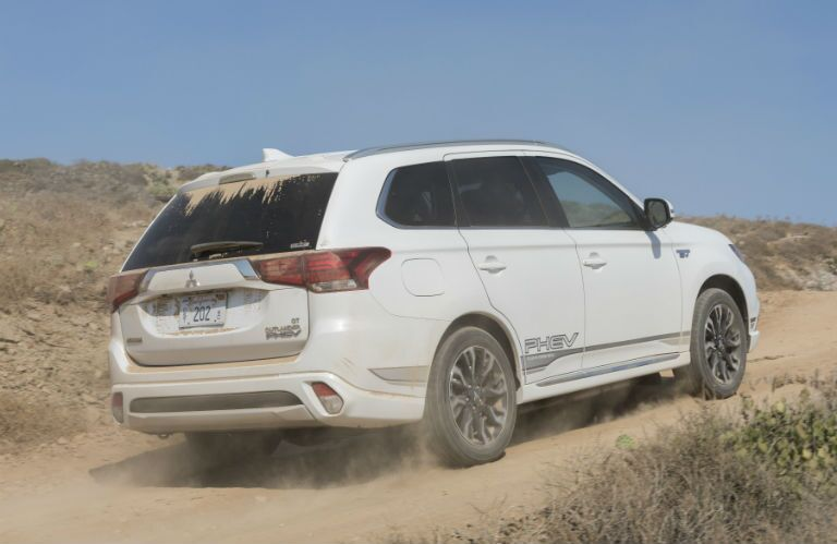 2018 Mitsubishi Outlander PHEV driving off-road in dirt and dust