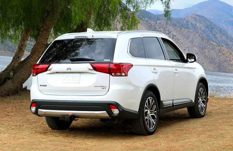 rear exterior view of a white 2018 Mitsubishi Outlander