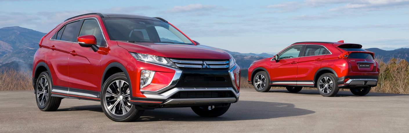 two red 2018 Mitsubishi Eclipse Cross SUVs parked cliffside