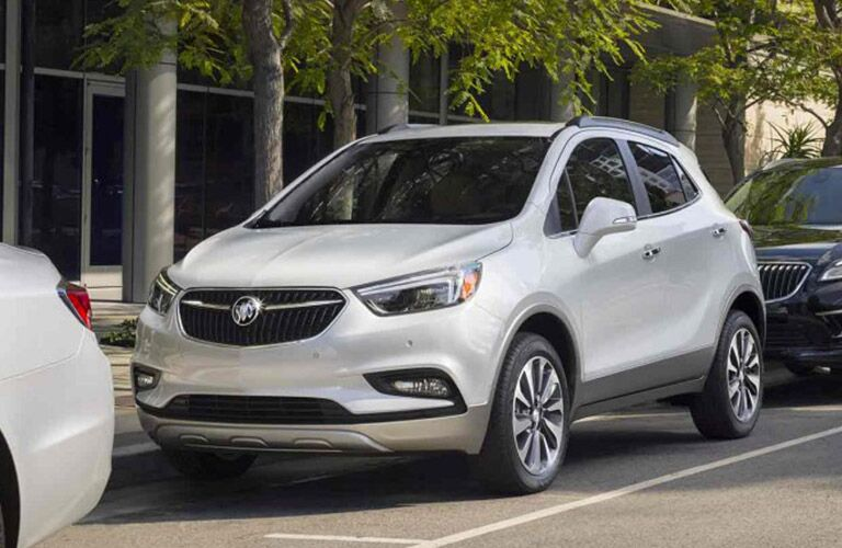 Exterior view of a silver 2018 Buick Encore parked curbside in the city