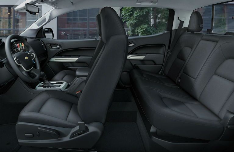 Interior view of a 2018 Chevrolet Colorado showing the front seats and rear bench seats