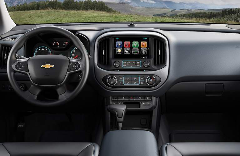 Interior view of a 2018 Chevrolet Colorado showing the steering wheel, touchscreen and dashboard