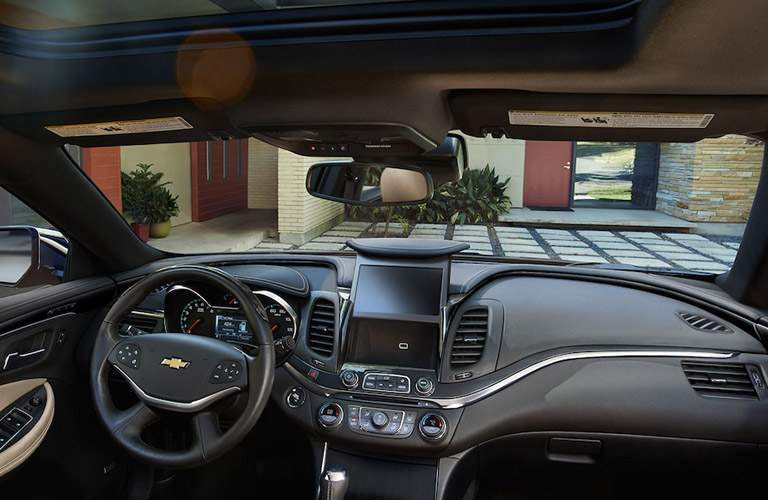 front interior of 2018 chevy impala including steering wheel, dashboard and infotainment system