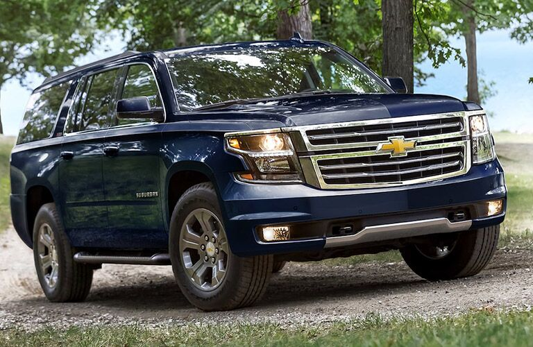 Blue 2018 Chevrolet Suburban parked in the woods
