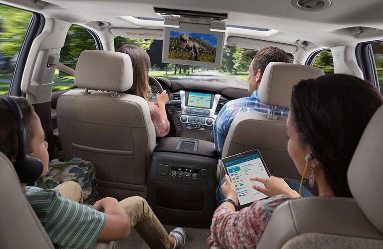 People enjoying the tv screen inside the 2018 Chevrolet Suburban