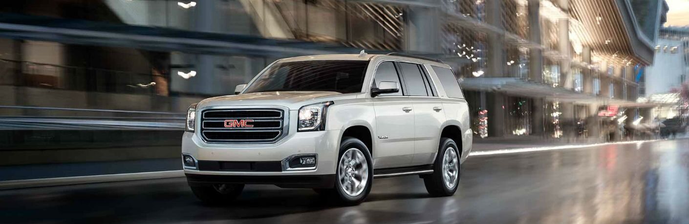 2018 GMC Yukon driving in the city