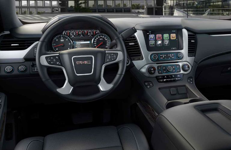 Interior view of the steering wheel and touchscreen of a 2018 GMC Yukon