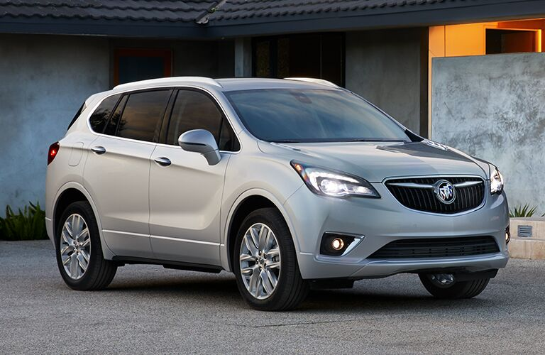 Exterior view of the front of a silver 2019 Buick Envision parked in a driveway